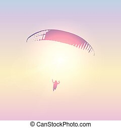 paraglider silhouette in sunny sky