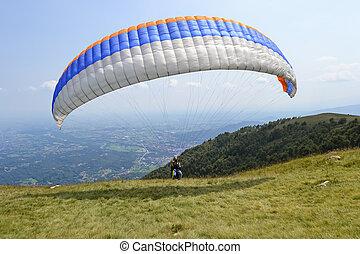 paraglider take-off - Paraglider pilot preparing for...