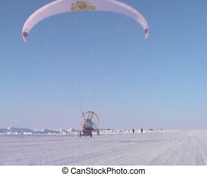 Paraglider with motor and propeller