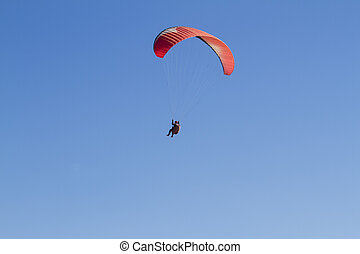Paragliding - A paraglider takes to the sky. Shot from below...