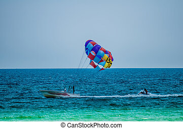 paragliding above the sea - paragliding in the clear sky...