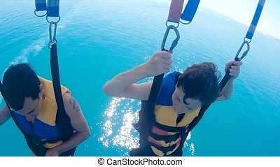 paragliding and parasailing. man and a boy lifestyle are...