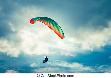 Paragliding extreme Sport with blue Sky and clouds on background Healthy Lifestyle and Freedom concept Summer Vacations