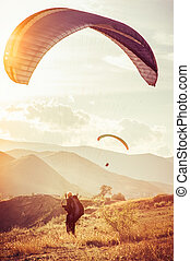 Paragliding extreme Sport with mountains on background Healthy Lifestyle and Freedom concept Summer Vacations