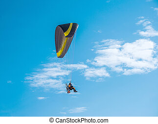 Paragliding fly on blue sky