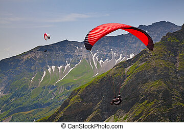 Paragliding in swiss alps near Pizol, Switzerland
