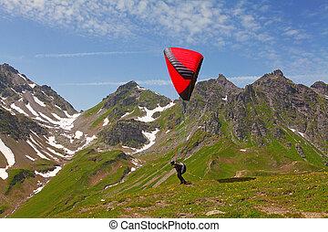 Paragliding in swiss alps near Pizol, Switzerland
