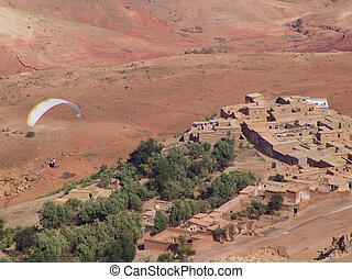 Paragliding in the Moroccan Atlas - A paraglider is flying ...