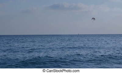 Paragliding in the sky above the sea