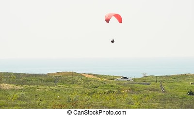 paragliding over coastline