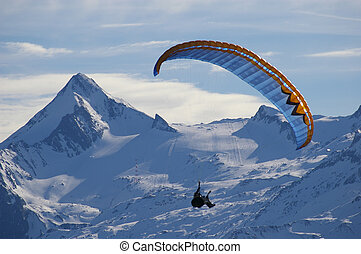 Paragliding over mountain in winter
