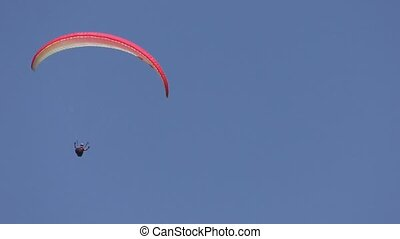 Paragliding over mountains to the valley 4K video