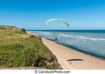 Paragliding over a beach in northern France