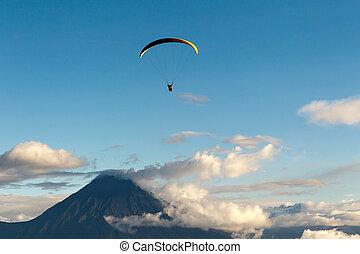 Paragliding Over Tungurahua Volcano In Ecuador Aerial View