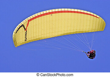 Paragliding - Paraglider is paragliding against clear blue...