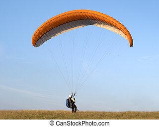 Paragliding - Paraglider landing in a field
