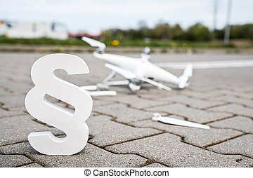 Paragraph the symbol of law and crashed uav drone. Drone and aviation law cocept
