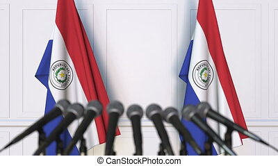 Paraguayan official press conference. Flags of Paraguay and...