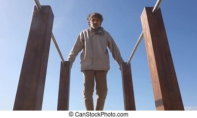 parallel bars outdoors - man exercising on parallel bars...