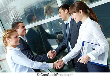 Parallel handshakes - Photo of two pairs of confident...