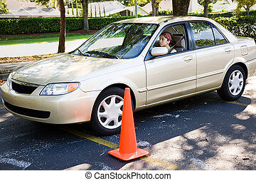 Parallel Parking - Teen girl learning to parallel park a car...