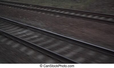Parallel railroad tracks. View from moving train window