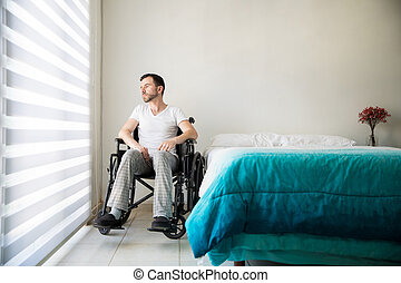 Paralyzed man feeling depressed at home