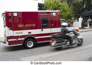 Paramedic 1 - A fire rescue vehicle blazes by with a police...