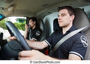 Paramedic Ambulance Driver - Portrait of EMS worker driving...
