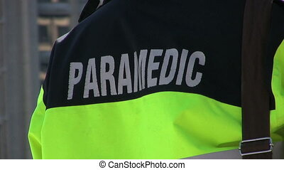 Paramedic-Black Jacket - A paramedic wearing a black and...