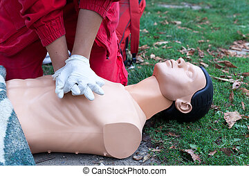 Paramedic demonstrate Cardiopulmonary resuscitation - CPR on dummy. First aid training.
