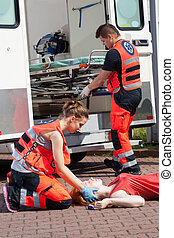 Paramedic giving first aid