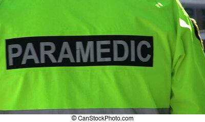 Paramedic-Green Jacket - A paramedic wearing a black and...