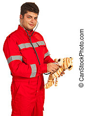Paramedic man examine plush toy