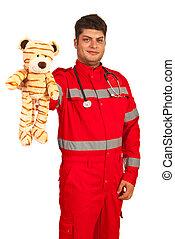 Paramedic man showing toy