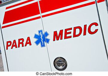 Close up of a Paramedic medical symbol for Emergency - Star of Life - on a fire truck. These trucks are first responders in the US to 911 emergency calls.