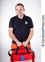 Paramedic with first aid kit - Vertical view of paramedic...