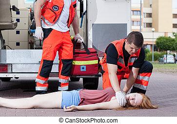 Paramedics applying first aid