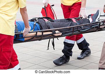 Paramedics evacuate an injured person