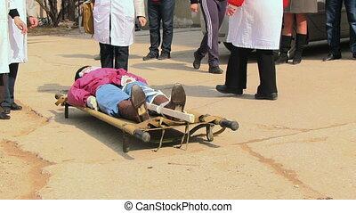 Paramedics immobilize victim's leg