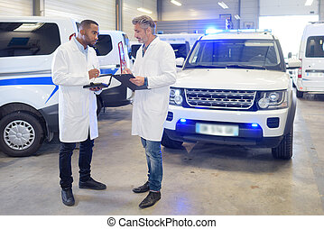 Paramedics in ambulance depot
