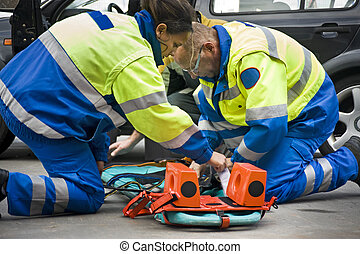 Paramedics preparing a stretcher for a wounded car accident...