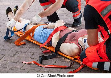 Paramedics taking woman to the hospital