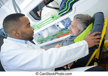 paramedics talking to the patient