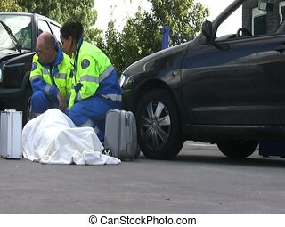 Paramedics - two paramedics tending to a severely wounded...