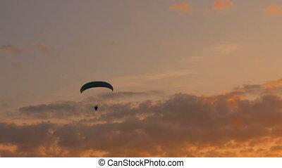 Paramotor flying on sky - Paramotor silhouette flying on sky...