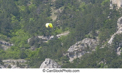 Paramotor Flying. Parachutist with the motor flies against...