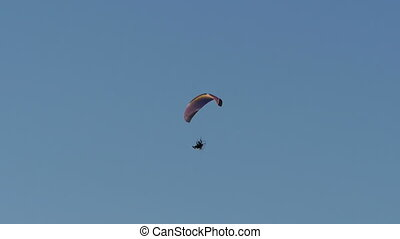 Paramotor high in the blue sky