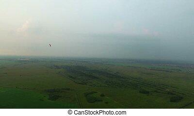 Paraplane in the air aerial shot