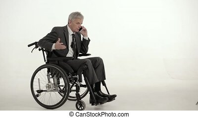 Paraplegic businessman on a wheelchair. Studio shot - Busy...